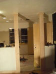 columns between the kitchen and dining room.